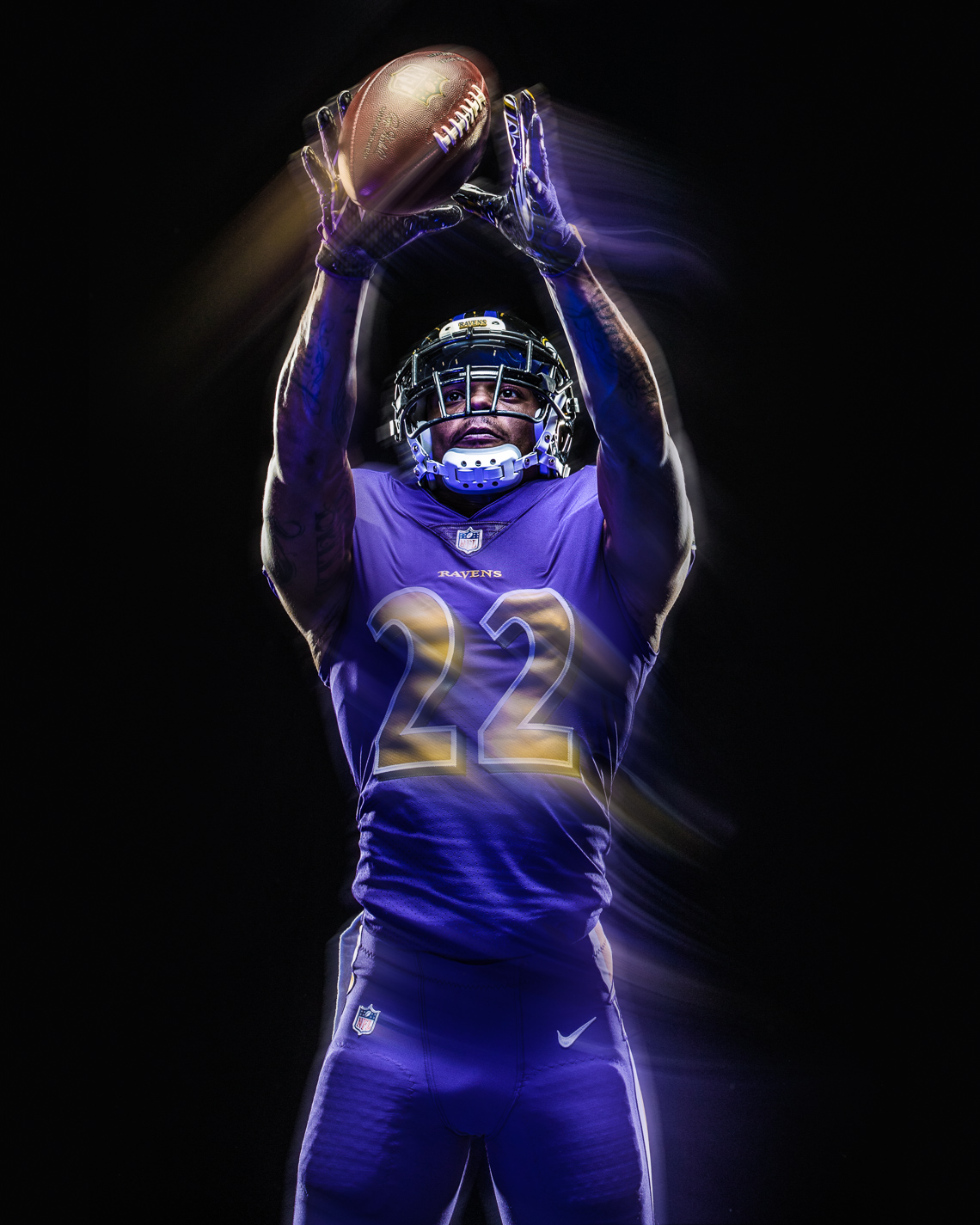 NFL Color Rush uniforms for Baltimore Ravens football team designed by NIKE football color rush photographed by commercial sports advertising photographer in baltimore maryland