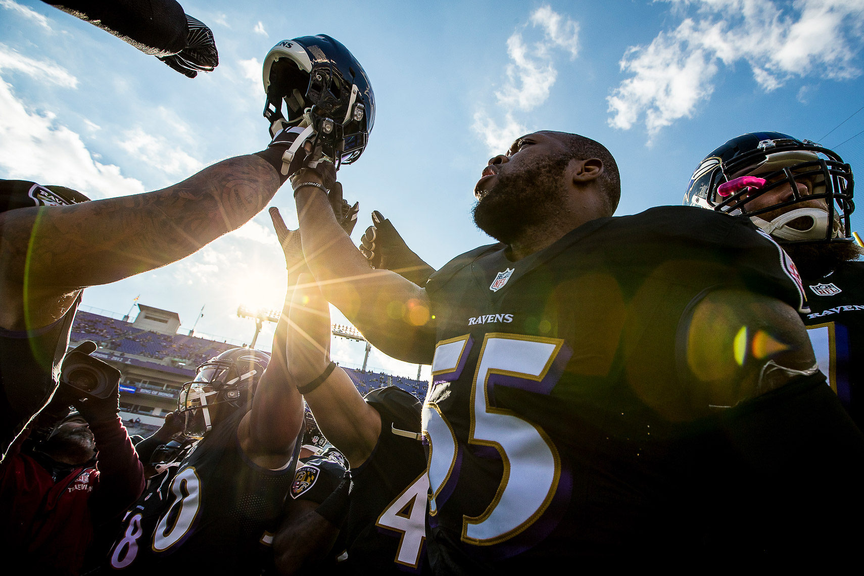 NFL football team Baltimore Ravens photographed in NIKE football uniforms by commercial advertising sports photographer in baltimore maryland showing sports action photography