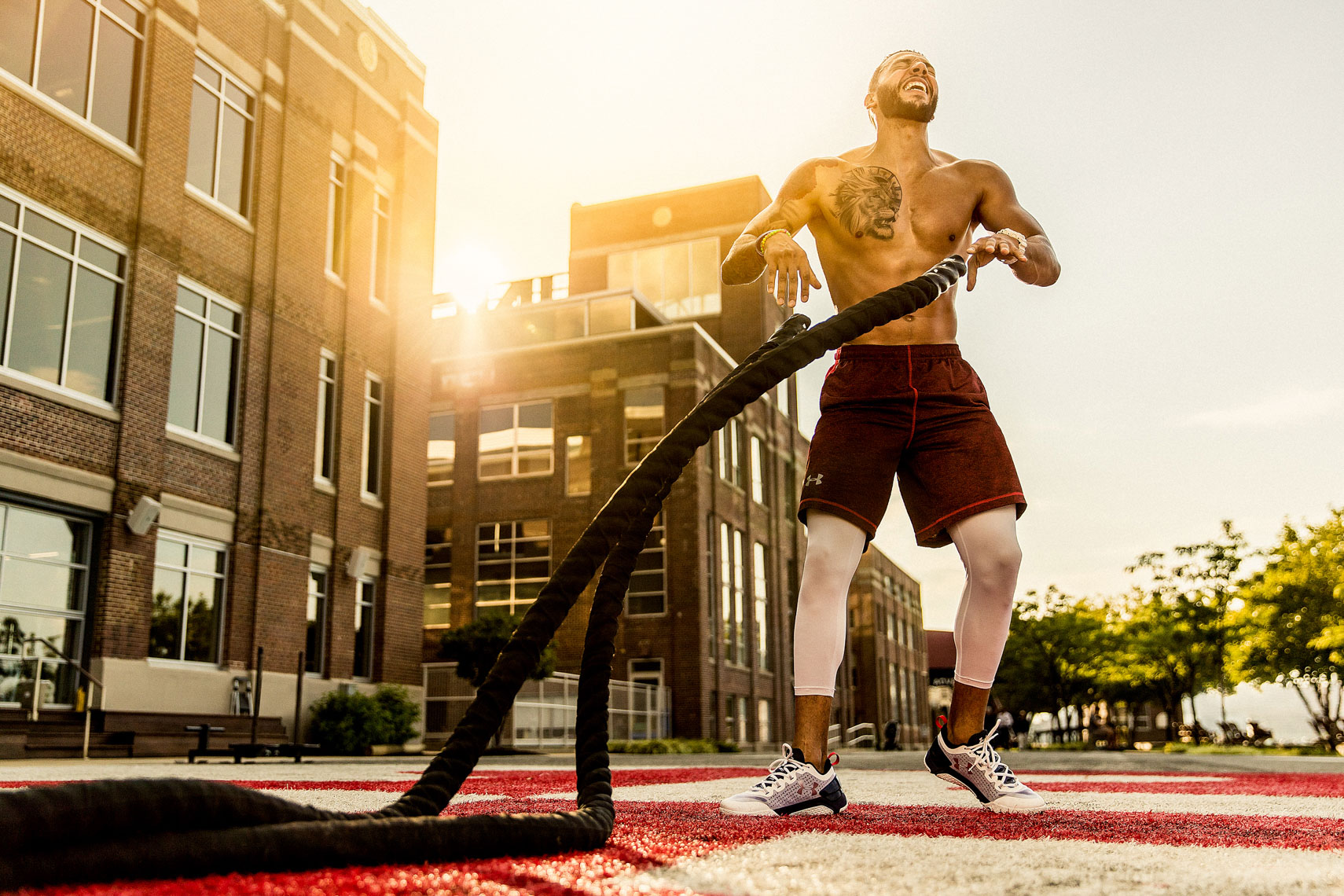 Fitness athlete training workout styled in Under Armour by advertising fitness active lifestyle photographer in Baltimore Maryland