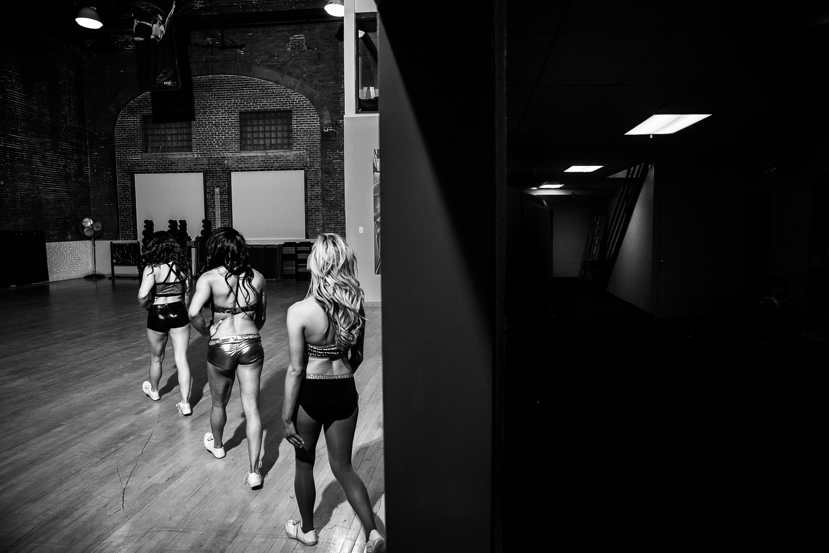 makingthecut12_ NFL cheerleaders cheerleading is a sport Baltimore Ravens cheerleading tryouts documentary photographer in Baltimore sports photojournalism documentary photos professional cheerleaders athletes cheerleading photos