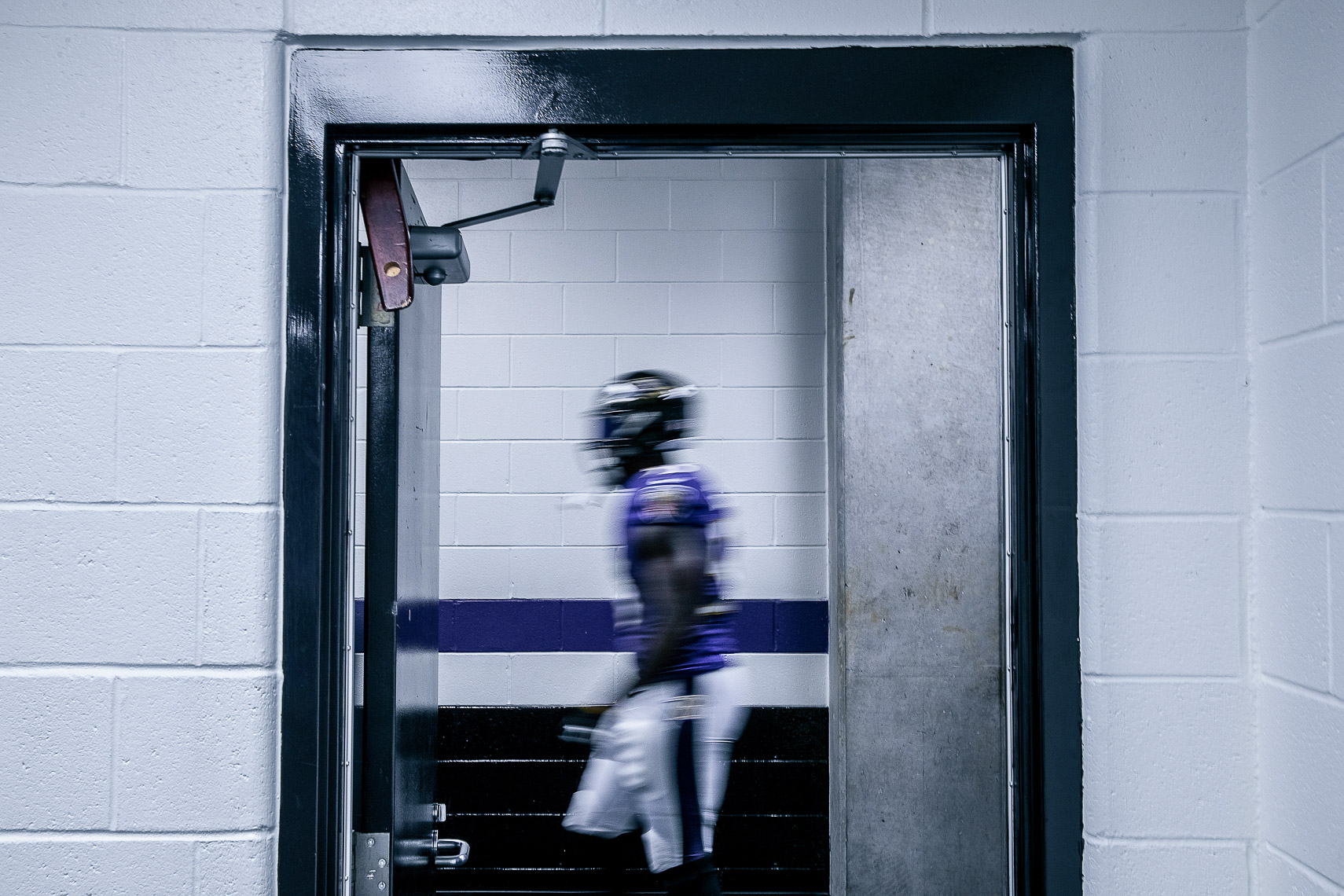 ravens03  NFL Baltimore Ravens photos of inside an NFL locker room behind the scenes NFL team photographer documentary sports photographer photo of Terrell Suggs