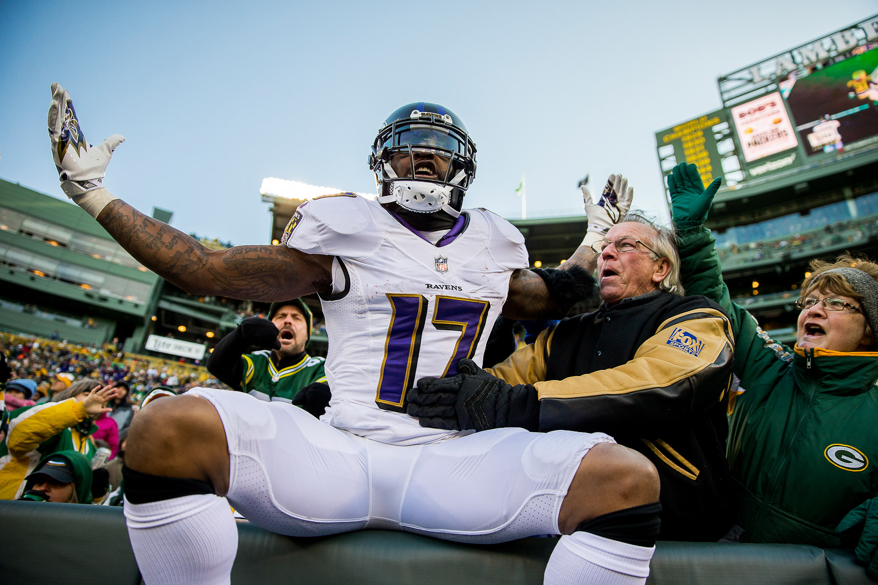 ravens22  NFL Baltimore Ravens photos NFL behind the scenes documentary sports photographer photo of receiver Mike Wallace Lambeau Leap