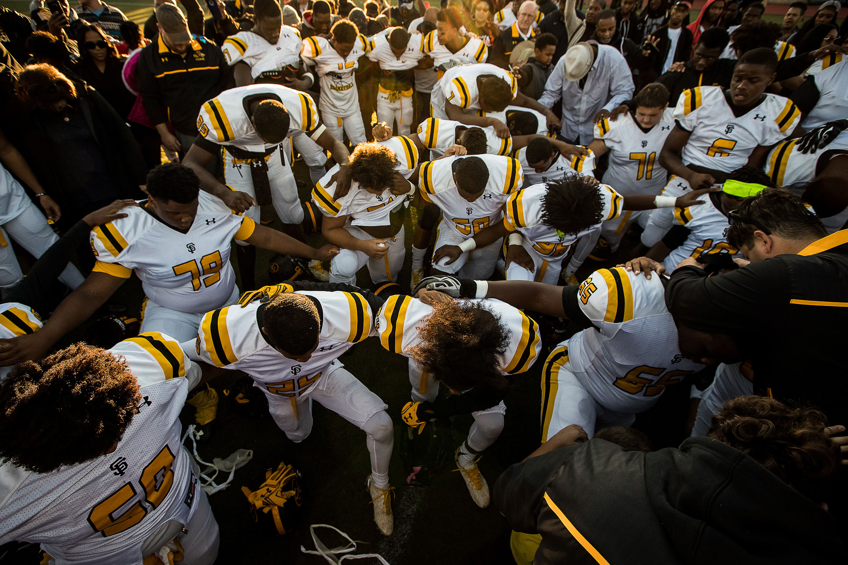 stfrances19_ St Frances Academy Panthers football Baltimore City poverty ESPN documentary MIAA Champions youth football team coached by former Gilman and Michigan football coach Biff Poggi Under Armour football team prayer